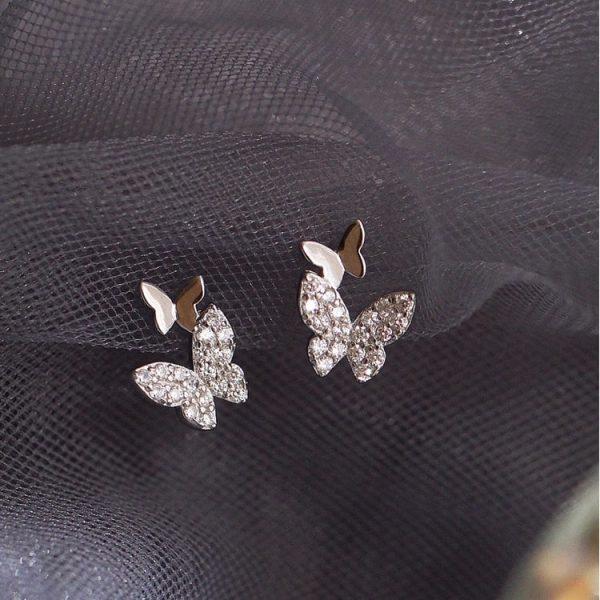 Boucle d'oreille à deux papillons avec zirconium