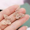 Boucle d'oreille papillon rose 2