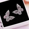 Boucle d'oreille papillon rose 3