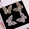 Boucle d'oreille papillon rose 4