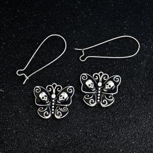Boucles d'oreilles papillon noire avec tête de mort