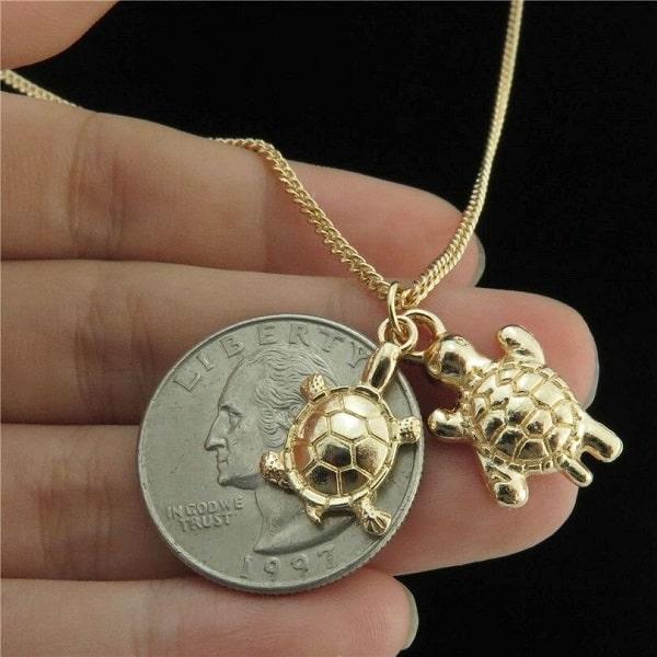 Collier avec 2 pendentifs tortue