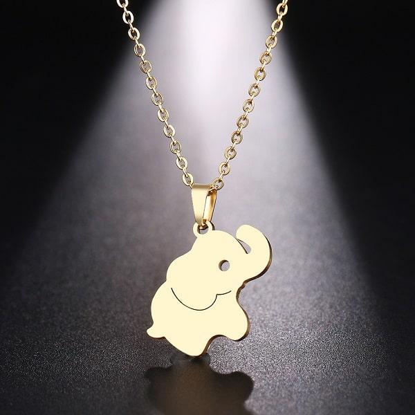 Pendentif éléphant femme, doré