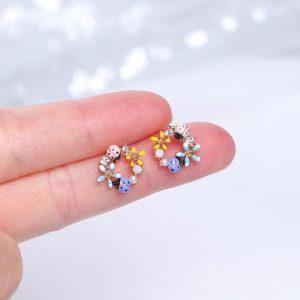 Boucle d'oreille ronde coccinelle à fleurs